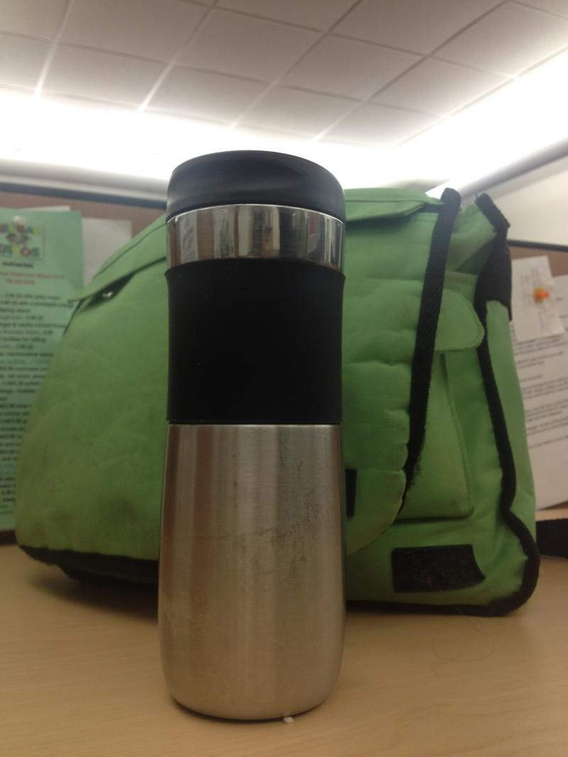 Clearly a freelancer, Trina Sargalski. Her thermos and satchel tell us she's always on the go. Also, see how ergonomically pleasing that mug is? Don't you want to pick it up and drink from it? Yeah, Trina's got an eye for good design. And good stories.