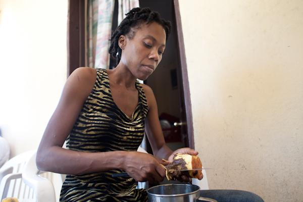 Fabienne prepares a meal for her daughter and mother at home.