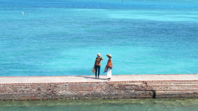 Walking on the moat in the Dry Tortugas.