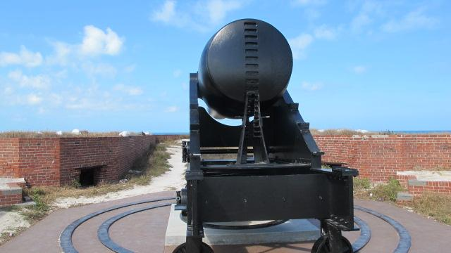 A cannon faces out to sea.