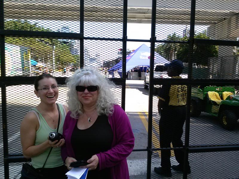 Audiologists Cindy Simon (right), and Allison Melograno (left) take sound levels outside the gates of Ultra Music Festival.  Even from outside the gates, levels were dangerously high for extended periods of time.