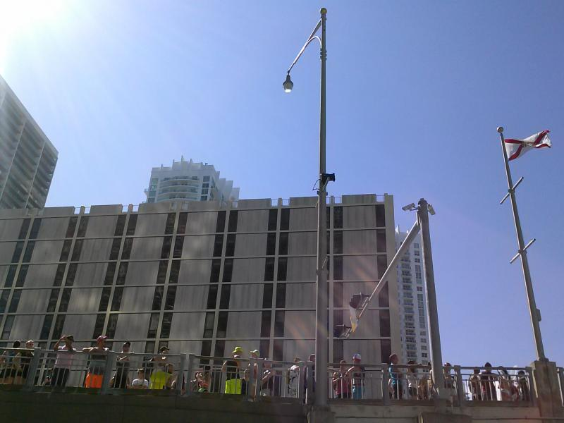 The party stops as the drawbridge goes up.  View from Miami Circle Park just off Brickell Avenue