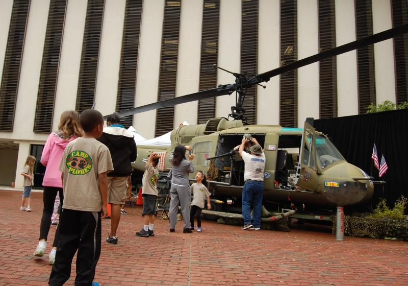 Visitors check out the military helicopter perched in the Capitol courtyard.