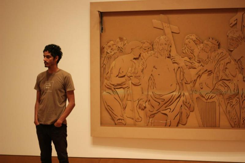 Featrured artist Leyden Rodriguez-Casanova observing the installation process by George Sanchez-Calderon's piece