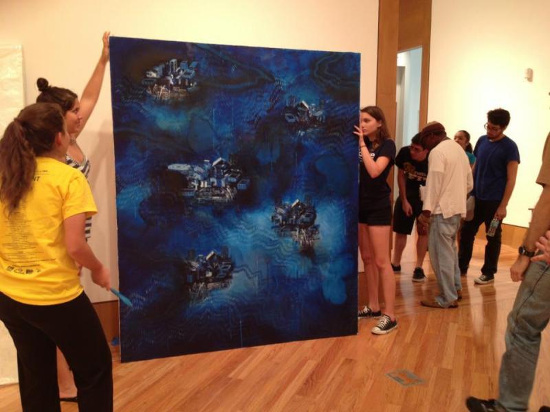 Students handling Luisa Basnuevo's piece