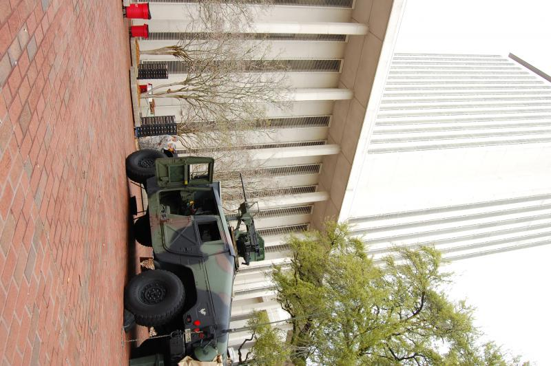 Camouflage Humvee with .50 caliber machine gun in the Capitol courtyard.