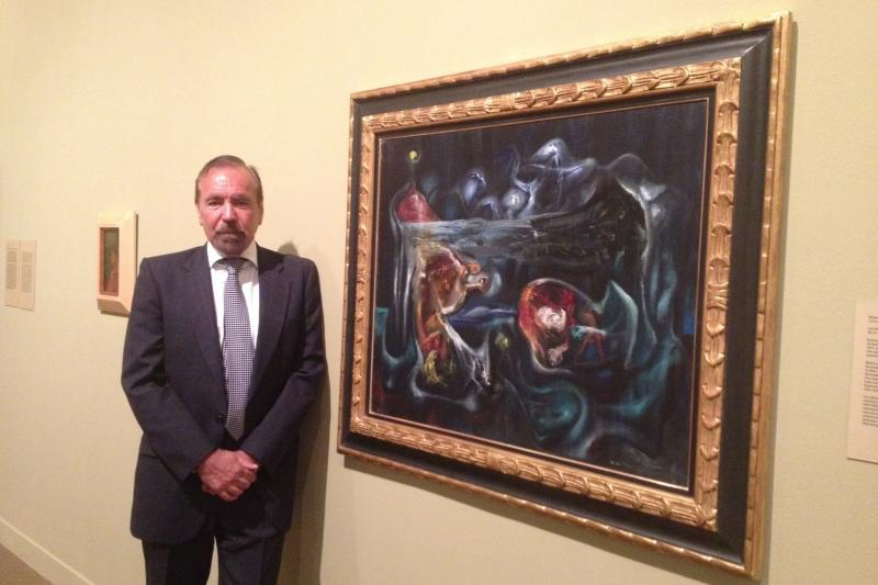 "Jorge Perez at the Miami Arts Museum, standing beside Robert Matta's ""Crucifixion"""