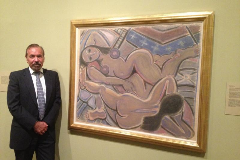 "Jorge Perez, standing beside, ""Double Nude II,"" by Cuban painter Wifredo Lam."