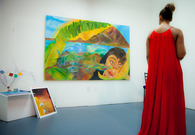 An unidentified woman views a painting at   Jude Papaloko's new studio in Wynwood.