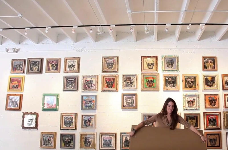 An unidentified worker at Peter Tunney's gallery prepares to display a painting in this screenshot from the film Right to Wynwood.