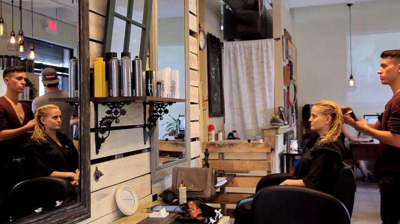 In this screenshot from the film Right to Wynwood, an unidentified woman gets her hair styled at the Junior and Hatter salon.