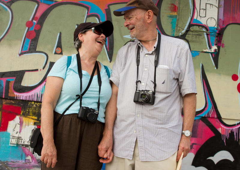 Robert Schor, executive director of The Blue Door Art Center in New York, and his wife tour around Wynwood for the first time.