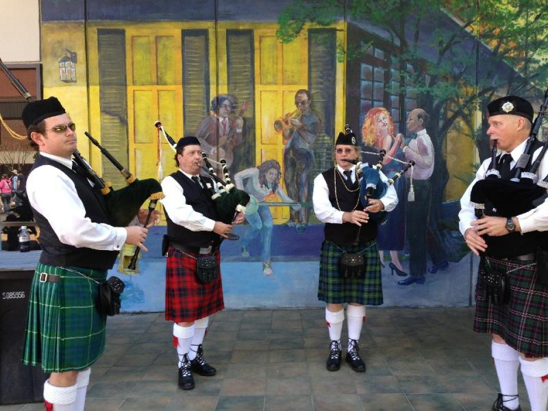 Bagpipers provide street entertainment after the parade.