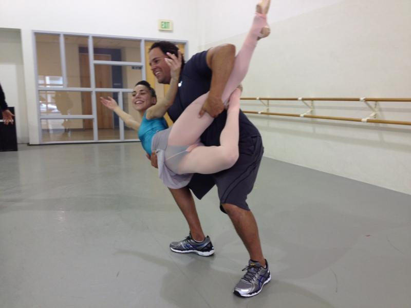 "Mike Piazza performs the ""fish dive"" with Miami City Ballet principal dancer Patricia Delgado."