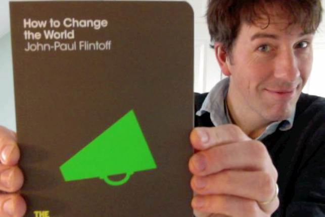 "John-Paul Flintoffa with his book, ""How to Change the World"""