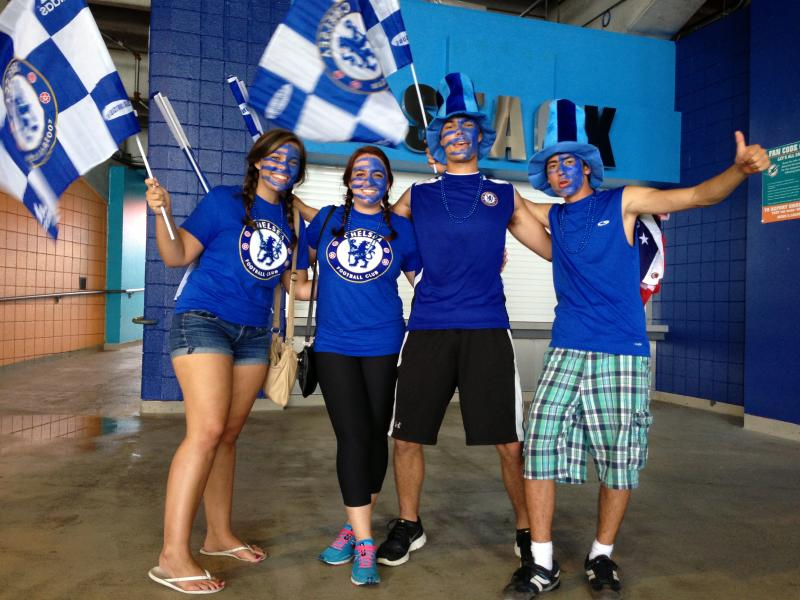 "(Left to right) Chloe Rodengen, Gennifer Williams, Kevin Rodengen and Emiliano Espinosa couldn't agree why they chose their Chelsea-blue facepaint design. ""It looked mean,"" said Kevin Rodengen. ""It came to us in a dream,"" said Gennifer Williams."