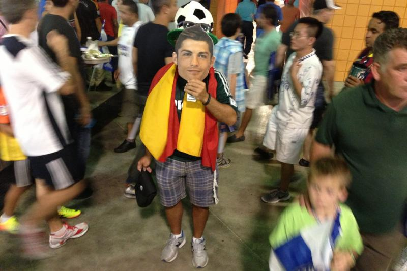 I challenge anyone to find a creepier picture from Wednesday's ICC matches! Real Madrid fan George Rodriguez hides behind a complimentary cardboard Cristiano Ronaldo mask.