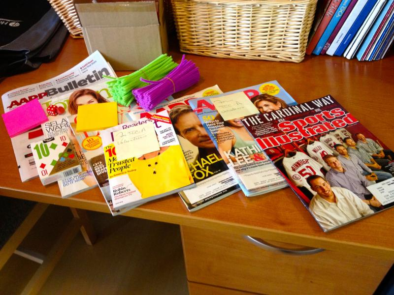 Volunteers use magazines and games to engage patients.