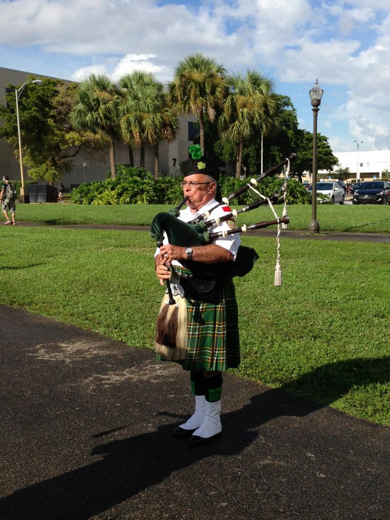 As the sun came out, bagpipers closed the ceremony.