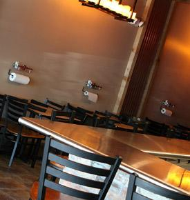 No white tablecloths here, you'll sit at our wooden tables or the stainless steel bar and pull from a roll of paper towels to wipe the sauce from your face.