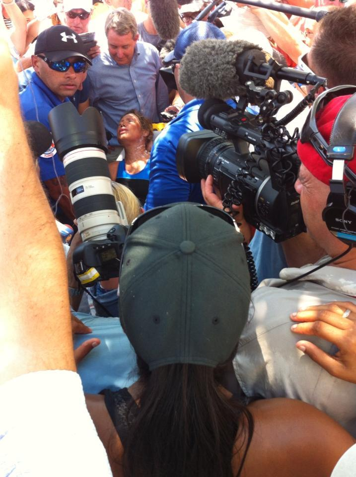 The press swarm an exhausted by joyful Nyad, fresh out of the water.