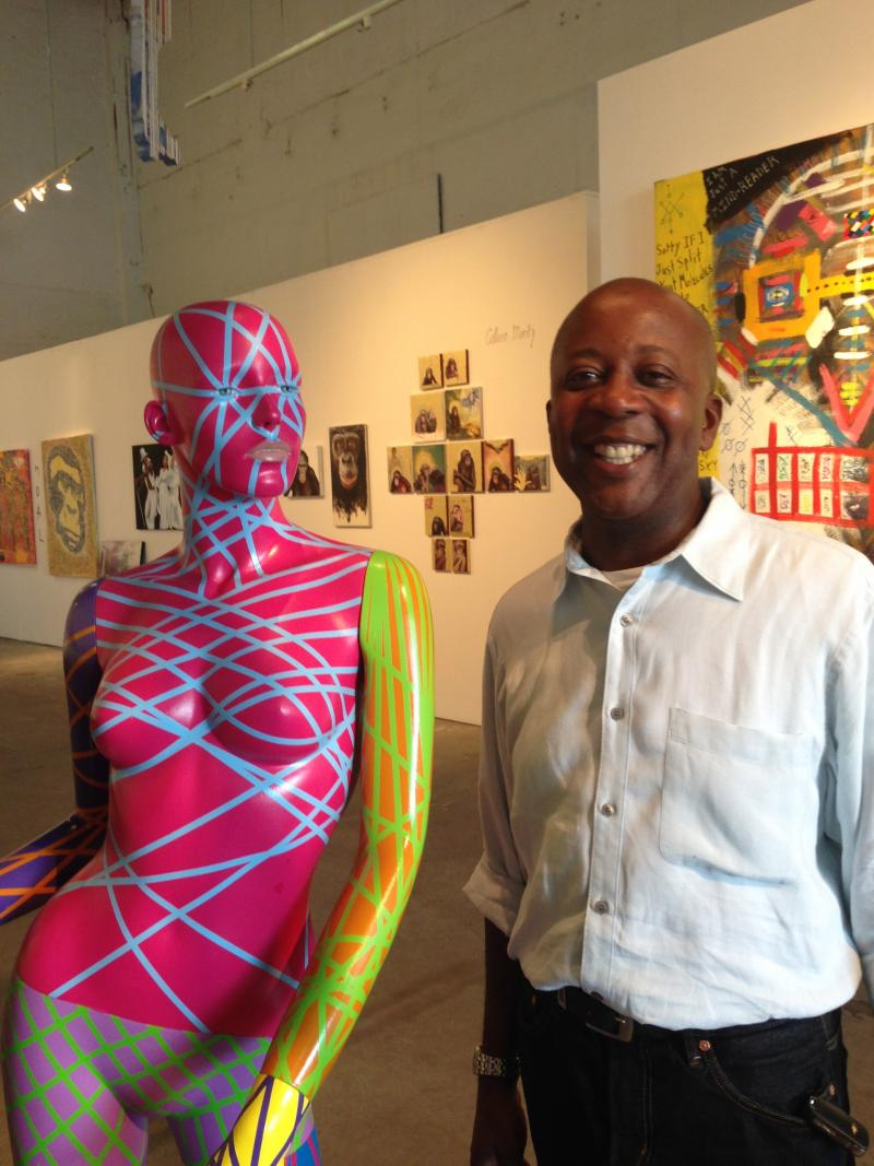 John West with some of the art at Multitudes Gallery.