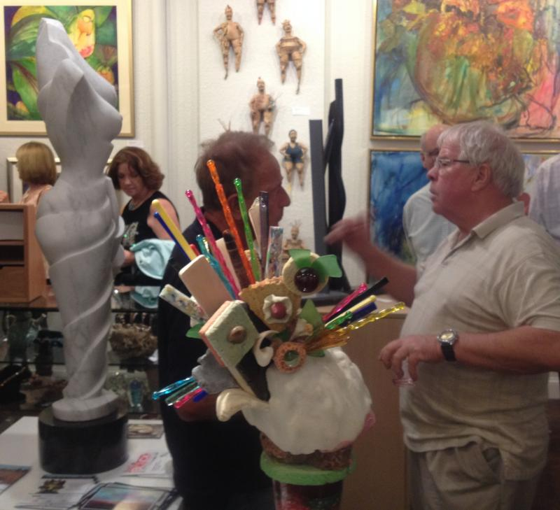 Patrons browse the art at Basel Broward
