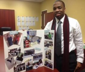 Brandon Clayton teaches all-boys classes at Bond Elementary School in Tallahassee. Here he shows off pictures from Dress For Success Wednesday.