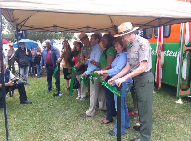 Members from both national parks, members of the city of Homestead and members of the Natonal Parks Conservation Association cut the ribbon together.