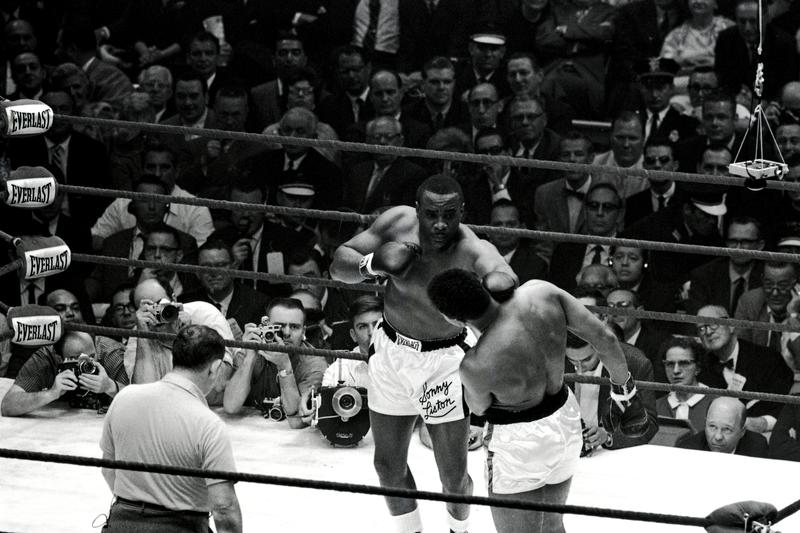A frustrated Liston jabs but Clay slips the punch.