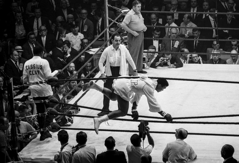 Clay leaps into the ring, where trainer Angelo Dundee and referee Barney Felix await.