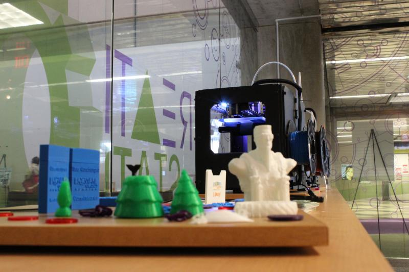 Objects made in the Creation Center's two 3D printers. They were in use at the moment of this shot.