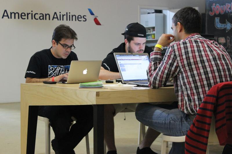 "Jose Pimienta and his team working on their award winning app ""Cuba Directo."""