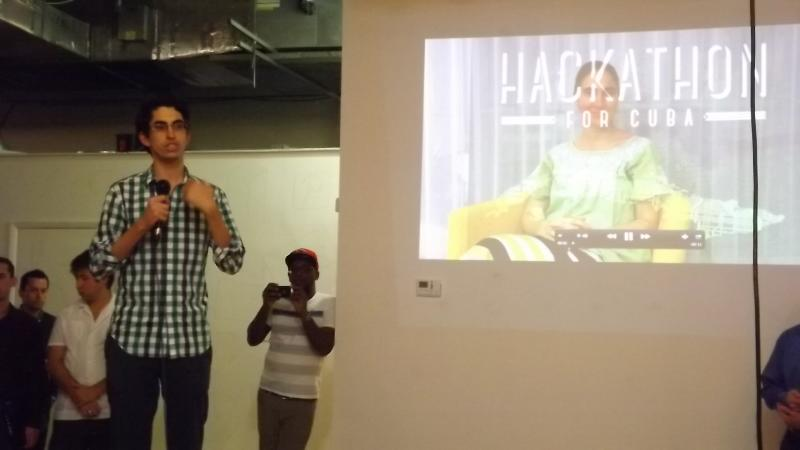 Roots of Hope's Raul Moas presenting Yoani Sanchez's video message in Friday's opening reception.