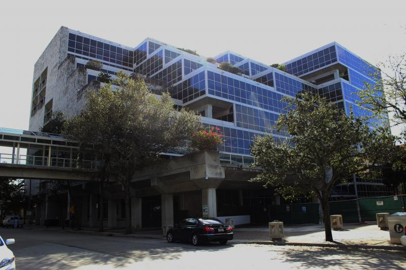 This exterior view of the building was taken from the middle of southeast first Ave., a few yards south of southeast first street . The bridge visible in the lower left frame connects the library to a municipal parking lot.