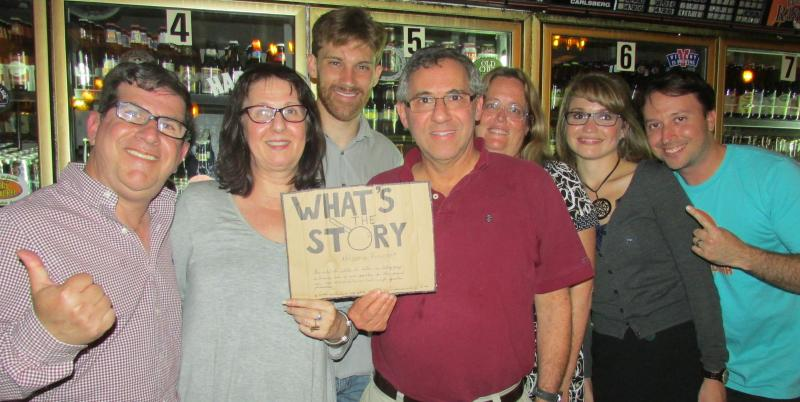The winning team poses with its designated WLRN/Herald staffer, Steve Rothaus (far left), and trivia-night host Kenny Malone (third from left). Click this photo to see more.