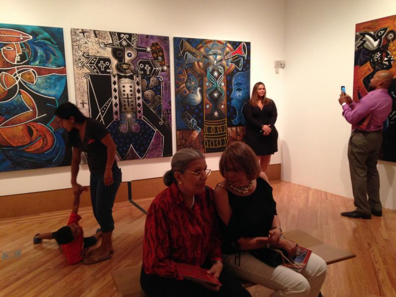 On opening night, some people were photographed next to vodou inspired paintings.