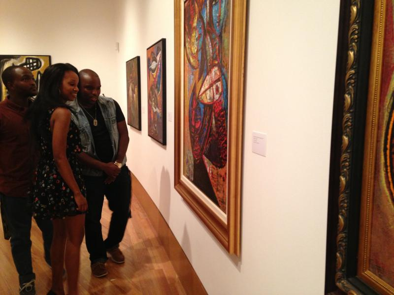 Phalancia Louisy, Haitian FIU junior, seeing Dodard's art work for the first time at the exhibit opening.