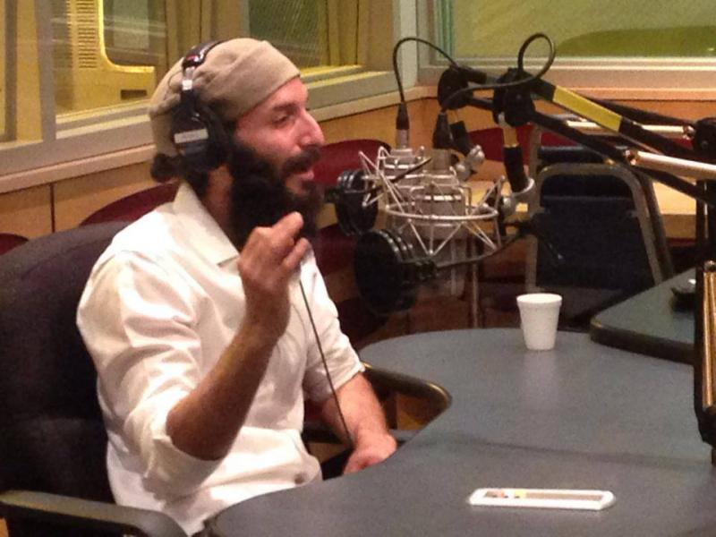 Zak the Baker in the Topical Currents studio at WLRN