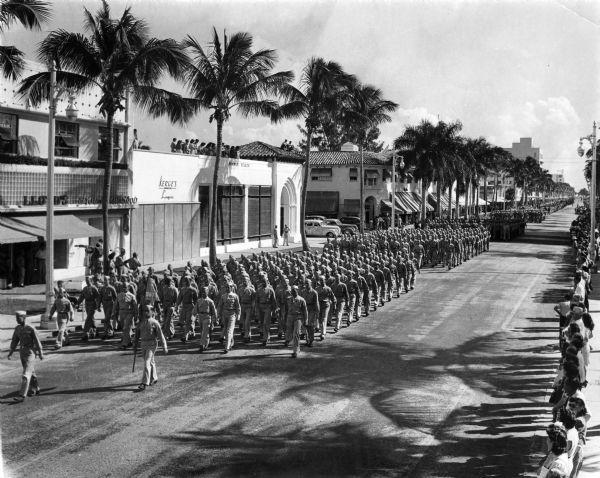 Servicemen march in a parade on Lincoln Road, Miami Beach. Circa 1943.