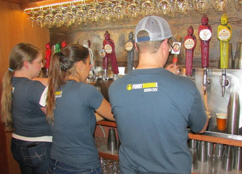 About 20 beer-tenders worked the bar at the Funky Buddha's first anniversary party in Oakland Park. Saturday, May 31, 2014.