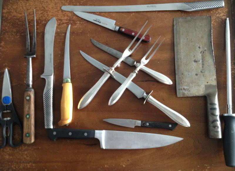 A collection of knives and other tools used by butchers
