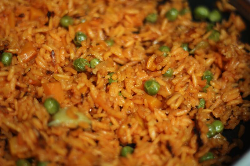 Red rice uses a sauce made with tomato, onions and garlic.
