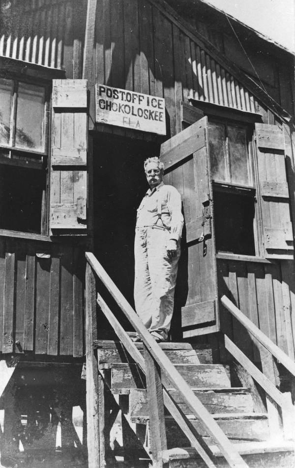 "Ted Smallwood in door of ""Ole Indian Trading Post""."