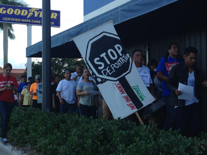 Protesters march along Homestead shopping centers.