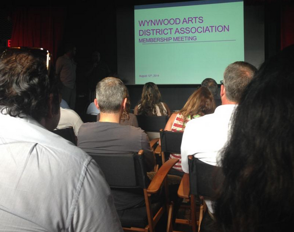 Members of the Wynwood Arts District Association (WADA) meet in a room in the back of Gramps bar.