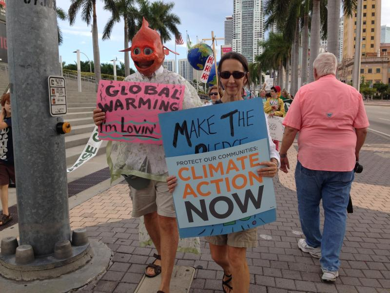 A few marchers passing in front of the American Airlines Arena.