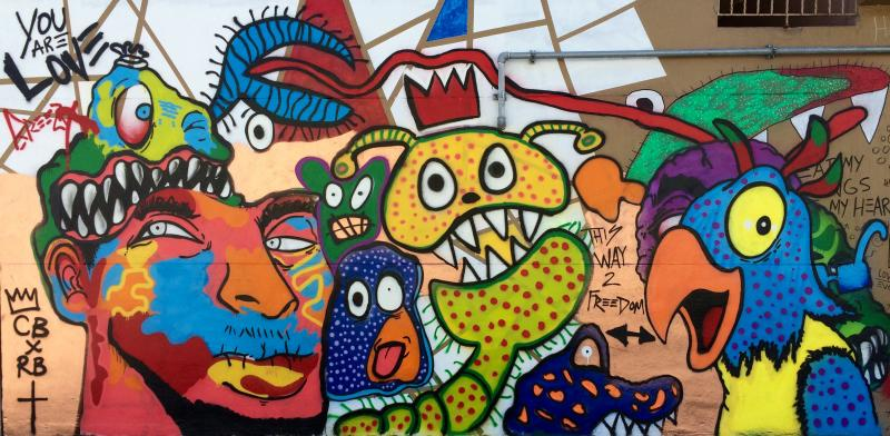 Chris brown paints mural for overtown children wlrn for Chris brown mural