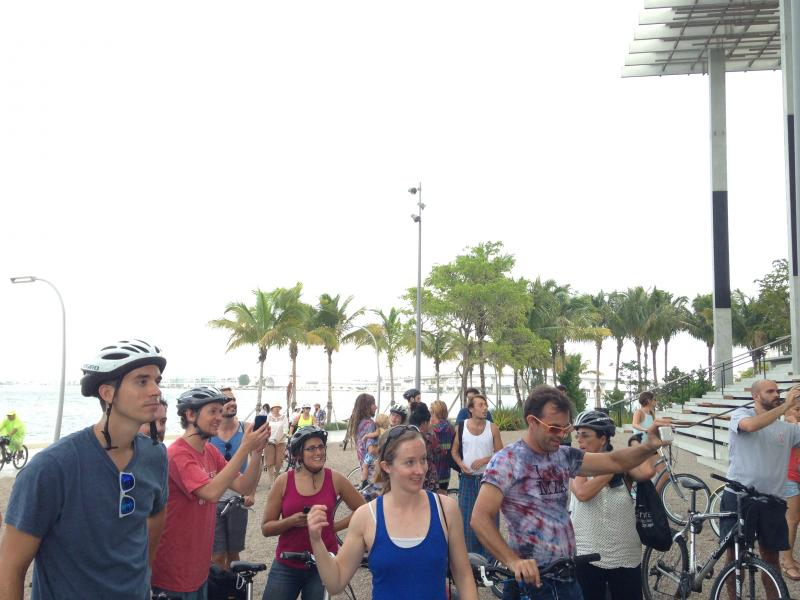 """Cyclists gathered outside Pérez Art Museum Miami for a """"History On Wheels"""" scene."""