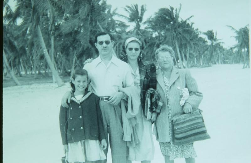 Judy with her dad, mom and grandma on Miami Beach in the late 1940s.